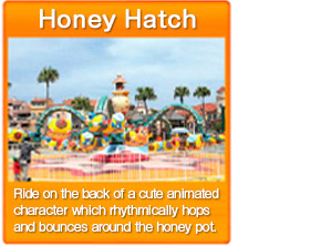 Honey Hatch Ride on the back of a cute animated character which rhythmically hops and bounces around the honey pot.